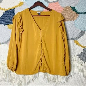 Mustard yellow cascading ruffle bubble hem blouse